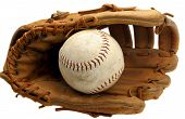 Old Baseball Mitt with Softball Isolated on White.
