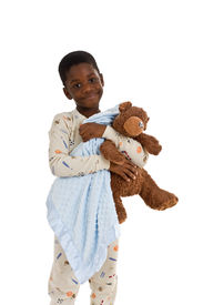 picture of goodnight  - Young African American boy wearing pajamas and holding a blue blanket and a well - JPG
