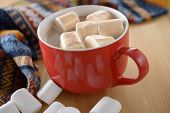 Hot chocolate with marshmallows in a red mug