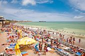 COSTINESTI, ROMANIA - AUGUST 8: Crowded beach with tourists in summer on August 8, 2012 in Costinest