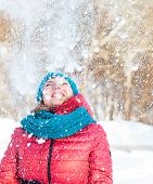 Young Woman Plays With Snow