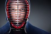 Head shot of kendoka. Asian martial arts concept