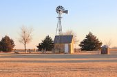 pic of kansas  - Antique farm windmill taken on the barren Great Plains of Kansas - JPG