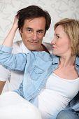 Woman caressing a man's hair