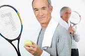senior couple playing tennis