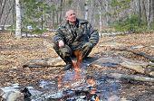 Man At Bonfire