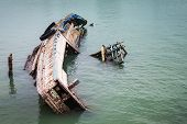 stock photo of shipwreck  - Close up old and damaged wreck ship in sea - JPG