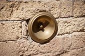 image of gatekeeper  - antique bell calling porter on the wall Italy - JPG