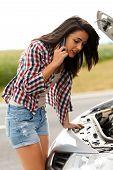 foto of nervous breakdown  - Nervous lady calling the emergncy sercive for her brokedown car - JPG