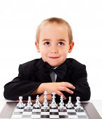 stock photo of playmate  - Cute little kid waiting for a playmate for a chess round - JPG