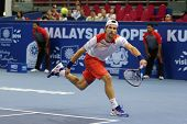 KUALA LUMPUR - SEPTEMBER 28: Jurgen Melzer plays a return to Joao Sousa in a semi-final match of the