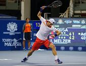 KUALA LUMPUR - SEPTEMBER 28: Jurgen Melzer thrashes his racket after a bad play in a semi-final match of the Malaysia Open 2013 tennis played at the Putra Stadium, Malaysia on September 28, 2013.
