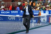 KUALA LUMPUR - SEPTEMBER 28: Umpire Mohamed Lahyani of Sweden preps up his linesmen before the semi-