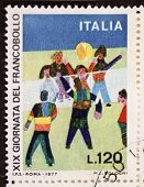 ITALY - CIRCA 1977: a stamp printed in Italy celebrates 19th Postage Stamp day showing an image of b