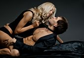 foto of human neck  - muscular handsome sexy guy with pretty woman on dark background glamour light - JPG