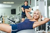 pic of execution  - happy  athletic girl execute exercise on muscles belly and smile in sport - JPG