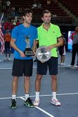 KUALA LUMPUR - SEPTEMBER 29: Winner Joao Souso (blue) and Julien Benneteau pose with their trophies after the singles final of the Malaysian Open 2013 in Putra Stadium, Malaysia on September 29, 2013.