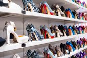stock photo of stiletto heels  - Background with shoes on shelves of shop - JPG