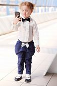 foto of bow tie hair  - Red hair little cute girl with bow - JPG