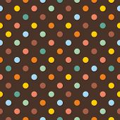 Seamless vector pattern or texture with colorful polka dots on dark brown background.