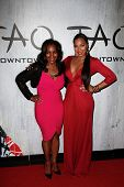 NEW YORK-SEP 28: Singer Ashanti (r) and mother Tina Douglas attend the grand opening of TAO Downtown at the Maritime Hotel on September 28, 2013 in New York City.