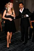 NEW YORK-SEP 28: Socialite Nicky Hilton (l) is escorted in by actor Wass Stevens at the grand opening of TAO Downtown at the Maritime Hotel on September 28, 2013 in New York City.