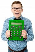 picture of unbelievable  - Happy young nerd showing big green calculator - JPG