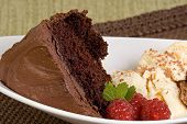 picture of chocolate fudge  - chocolate fudge cake with vanilla ice cream and raspberries - JPG