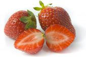 Two Ripe Strawberries And Two Segments Of A Strawberry