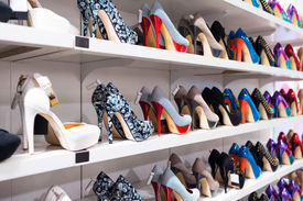 pic of stiletto  - Background with shoes on shelves of shop - JPG