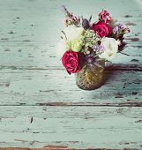 Fresh red roses and white flower bouquets in romantic style on grunge table, with space for text