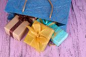 Presents with paper bag on wooden background