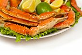 pic of cooked crab  - Snow Crab legs with fresh lemon slices - JPG