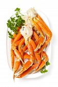 stock photo of cooked crab  - Snow Crab Legs with lemon and parsley - JPG