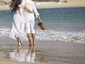 Lovers On Beach