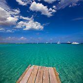 Formentera tropical Mediterranean sea wooden pier in Illetes beach Balearic Islands