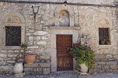 church entrance and flowerpots