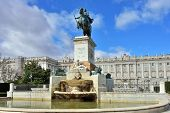 picture of royal palace  - Monument to Philip IV on Plaza de Oriente Central Gardens located between the Royal Palace and the Royal Theatre in Madrid Spain - JPG