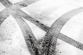 Transportation Background With Tire Tracks On Wet Snow