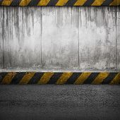 Concrete Wall And Asphalt. Abstract Interior Background