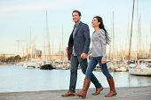 Young couple walking outdoors in old harbor, Port Vell in Barcelona Catalonia, Spain. Romantic happy