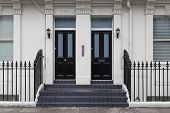 picture of victorian houses  - Two black doors at Victorian house in London - JPG