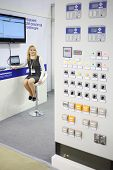 MOSCOW, RUSSIA - DEC 4, 2013: Woman at stand of company at Exhibition Electrical Networks of Russia