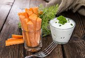 picture of crudites  - Fresh made Carrot Sticks in a glass  - JPG