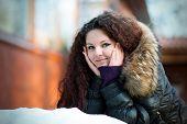 Portrait of a beautiful girl in winter