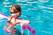 foto of swimming  - Adorable little girl at swimming pool - JPG