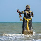 Statue of Pee Seua Samut, the character of a Thai book, at Puek Tiam beach, Cha-Am, Thailand