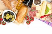 Cheese, prosciutto, bread, vegetables and spices. Isolated on white background with copy space