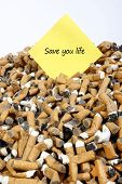 Many Dirty Cigarettes Butts Background With Message