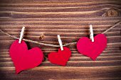 Three Hearts In Different Sizes On A Line